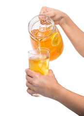 Female hand pouring ice lemon tea into a glass