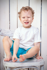 Laughing boy on chair