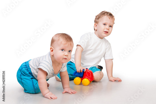 Playing children isolated on white