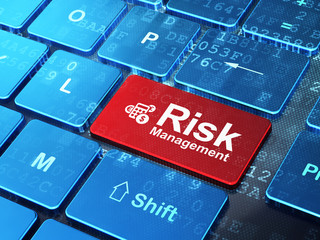 Business concept: Calculator and Risk Management on computer