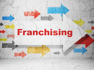 Finance concept: arrow with Franchising on grunge wall