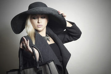 Beautiful Blond Woman in Hat. with Handbag.Spring Collection