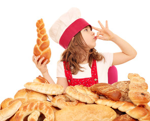 little girl cook with bread and ok hand sign