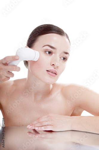 Woman with brush for deep cleansing facial. Skin care concept. H