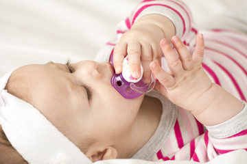 Cute little baby with pacifier