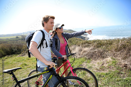 Couple on biking day looking at scenery