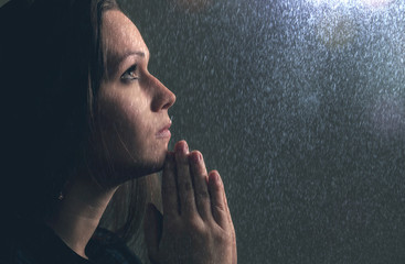Praying in the rain