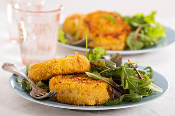 Tuna patties with potato and corn