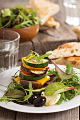 Grilled vegetables stacked on plate