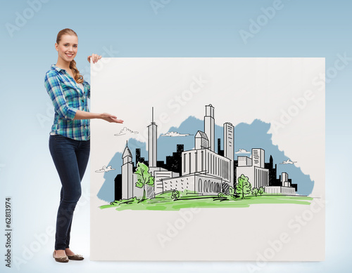 smiling young woman with board and city drawing