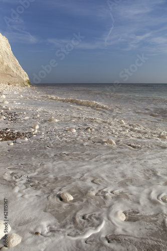 Waves at Seven Sisters cliffs in East Sussex, England.