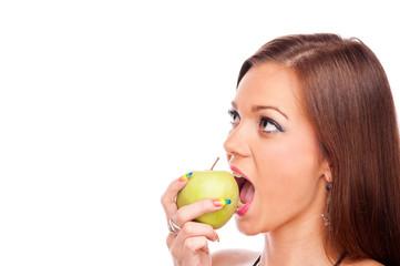 Woman eating green apple