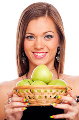 Woman holding punnet with green apples