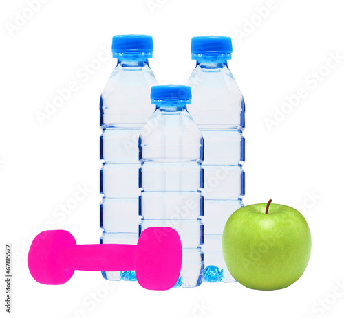 Blue bottles with water, dumbell and green apple isolated on whi