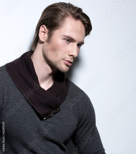 Handsome sexy man in gray pullover.