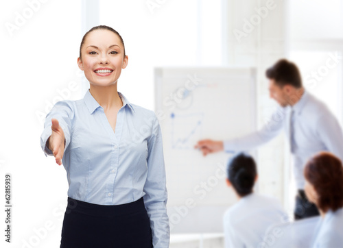 businesswoman with opened hand ready for handshake
