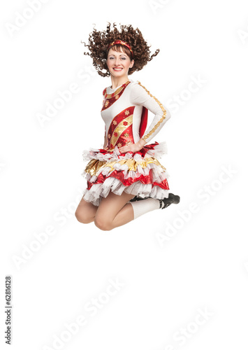 Young woman in irish dance dress jumping