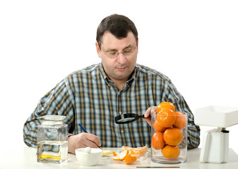 Phytocontrol expert inspects the appearance of tangerine slices
