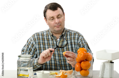 Phytocontrol engineer stares at the mandarine slice