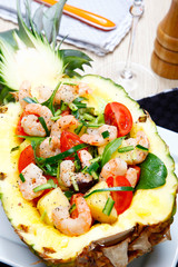 Shrimps salad in a pineapple.