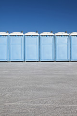 Row of portable toilets on Bonneville Salt Flats, during Speed Week