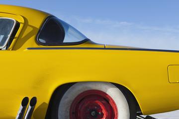 A vintage Studebaker race car, rear section, on Bonneville Salt Flats race track, during Speed Week.