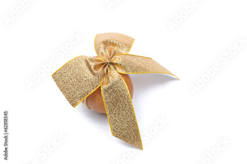 Easter egg tied by gold ribbon isolated