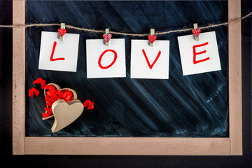 paper cards with letters LOVE attached with clothes pins on the
