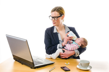 Businesswoman feeding baby
