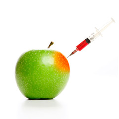 A syringe on a GMO, trangenic, apple.