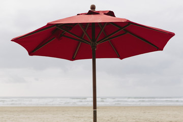 A large beach umbrella on the beach at Manzanita, on the Pacific Ocean in Oregon.
