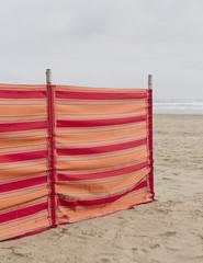 A red striped windbreak on Cannon Beach on the Oregon coast.
