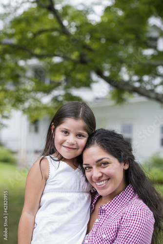 A mother and daughter in a country garden.