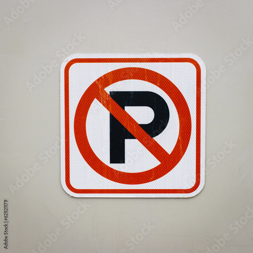 A traffic sign, No Parking sign.