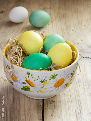 Colorful  easter eggs in bowl nets.