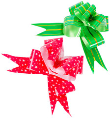 Two bows made from green and red ribbons isolated