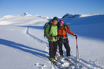 Two skiers on the Wapta Traverse track, a hut-to-hut ski tour in the Rockies in Alberta, Canada.