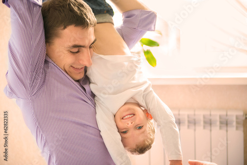 Happy father playing with son