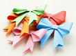colored paper origami bows for holiday cards