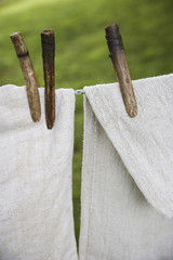 A washing line with household linens and washing hung out to dry in the fresh air.