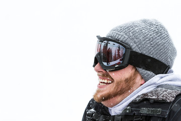 happy male in snow gear