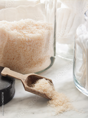 Sturdy glass storage jars for body scrub granules and for cottonwool and other personal grooming items.