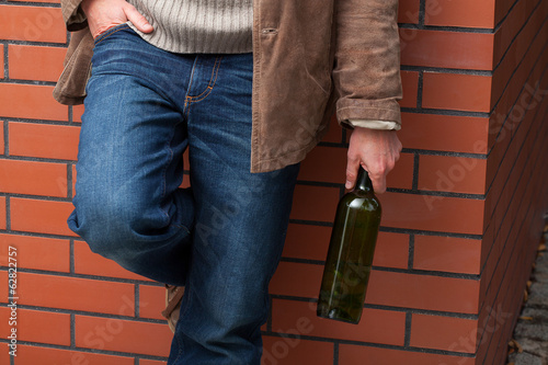 Adult man with bottle of wine