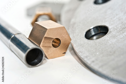 Metal flange pipe and brass nut. Milling and lathe industry