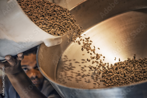 Processing coffee beans for roasting and blending at a farm which imports coffee beans.