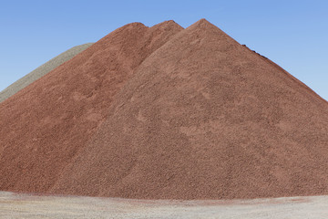 Gravel piles are used for road maintenance and construction purposes