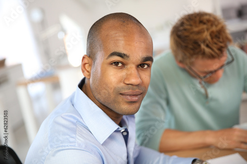 Portrait of young man in business meeting