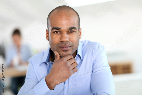 Portrait of young businessman with blue shirt