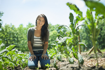 A young woman on a traditional farm in the countryside of New York State, USA