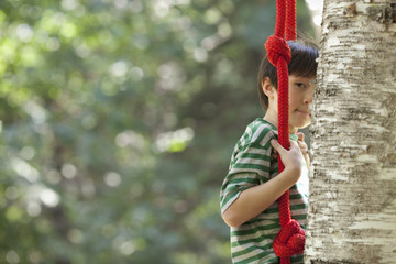 A child on a swing, playing outdoors.